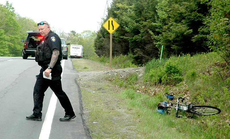 Officer Larry Hesseltine, of the Waldoboro Police Department, investigates the scene of a truck vs. bicycle collision on Route 1 in Waldoboro the afternoon of Wednesday, May 24. (Alexander Violo photo)