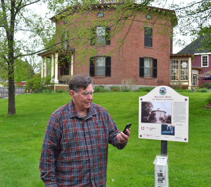 Ed Kavanagh holds a mobile phone in front of his home, the Octagon House, one of the stops on Wiscasset's Museum in the Streets tour, on Thursday, May 25. The tour is now available as an app. (Abigail Adams photo)