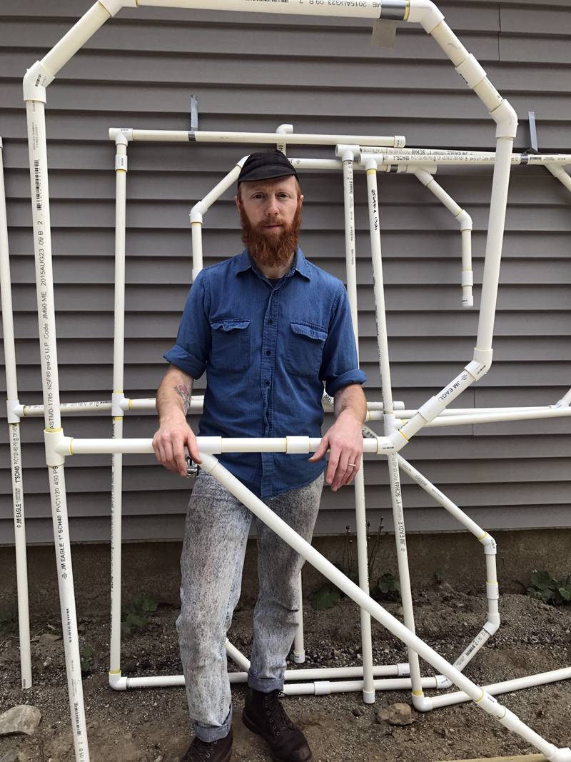 """Wiscasset artist Nick Dalton stands with sections of his public-art piece """"Hesper"""" several days before its installation at the Recreational Pier in Wiscasset, near QT's Ice Cream Parlor. (Photo courtesy Nick Dalton)"""