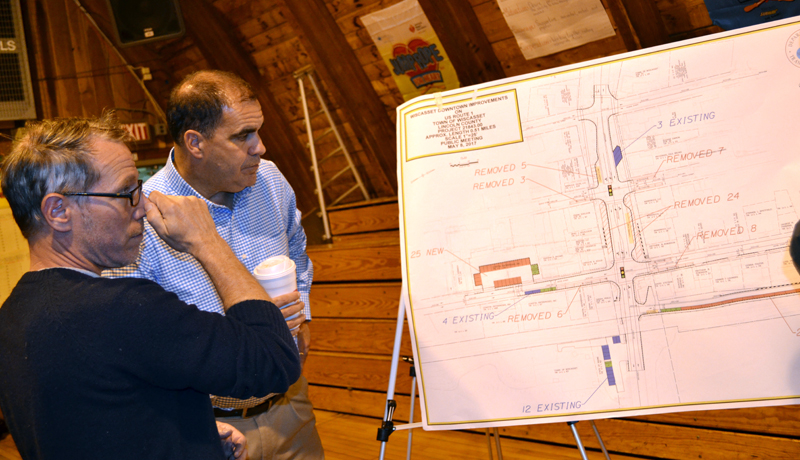 Wiscasset downtown business owner Jay McNamara (left) reviews a diagram of the dowtown parking proposal with Maine Department of Transportation Project Manager Ernie Martin on Monday, May 8. (Abigail Adams photo)
