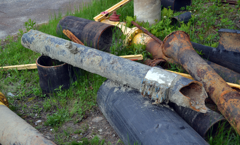 A section of water pipe more more than a century old, replaced as part of the Wiscasset Water District's infrastructure improvement project, outside the district's office Tuesday, May 23. (Abigail Adams photo)