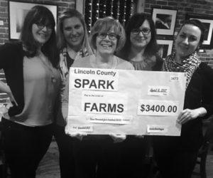 From left: Brynne Hanna, Taylor Corson, Jean Kerrigan, Cerina Leeman, and Annie Avantaggio,as Avantaggio presents a check to Kerrigan, who is a FARMS board member.