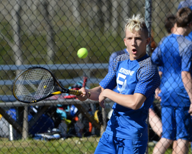 Erskine Academy boys tennsi player Michael Sprague, of Jefferson, returns a shot against Lincoln Academy, (Paula Roberts photo)