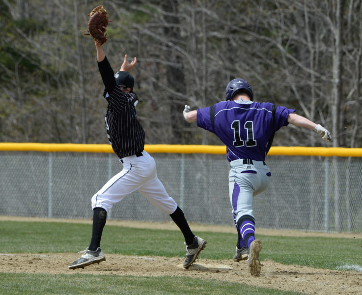 "Eagle first baseman Tiger Cumming stretches to pick up the out on Waterville""s Jackson Aldrich. (Paula Roberts photo)"