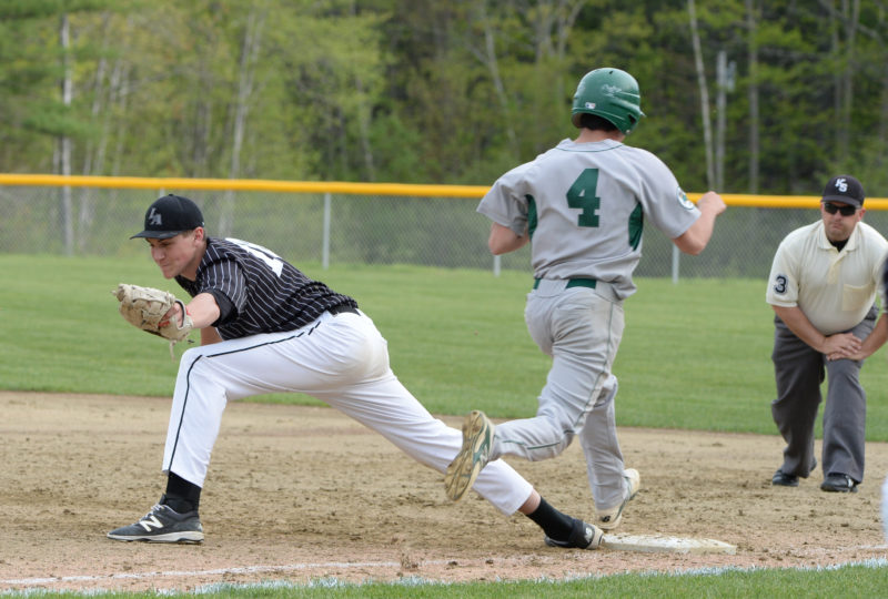 Andrew Greenleaf stretches to pick up the out on Leavitt base runner David Herman. (Paula Roberts photo)