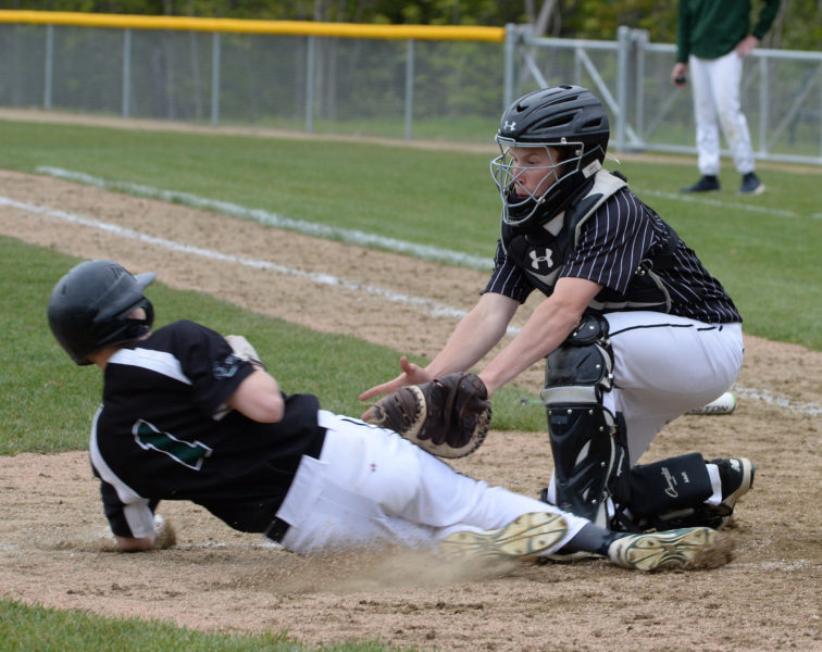 Oakley Oliver tags out Hunter Dalton at the plate. (Paula Roberts photo)