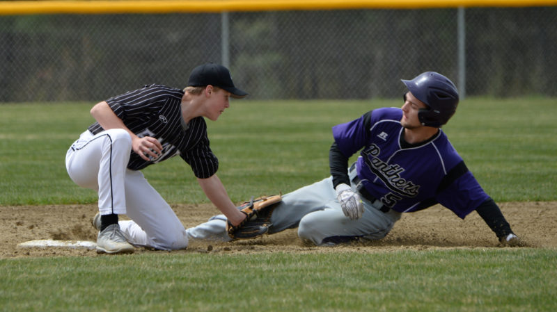 Lincoln Academy second baseman Jon Pinkham tags out Andrew Roderigue trying to steal second. (Paula Roberts photo)