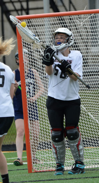 Lincoln Academy senior Emily Huber makes a save in net against Boothbay. (Paula Roberts photo)
