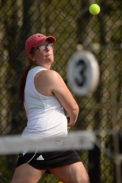 Polina Scimone prepares to return a shot in her 6-0, 6-0 win at third singles. (Paula Roberts photo)