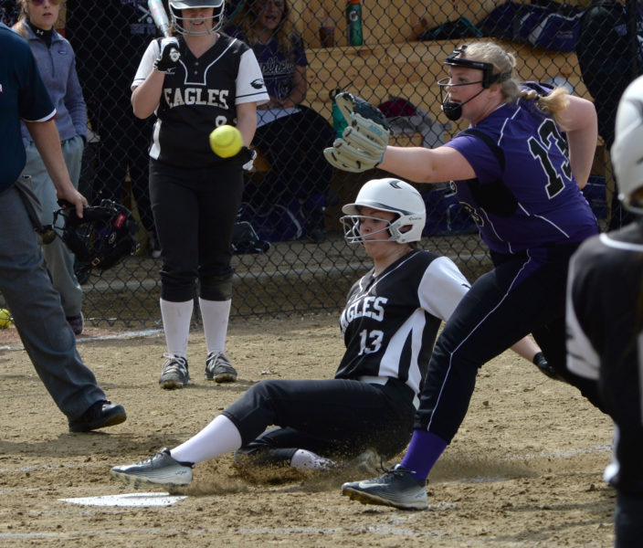Kortney McKenna scores on a passed ball for the Lady Eagles. (Paula Roberts photo)