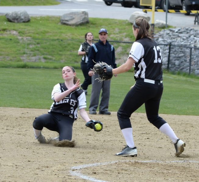 Madeline York makes a diving catch on a pop-fly behind Eagle catcher Kortney Mckenna. (Paula Roberts photo)