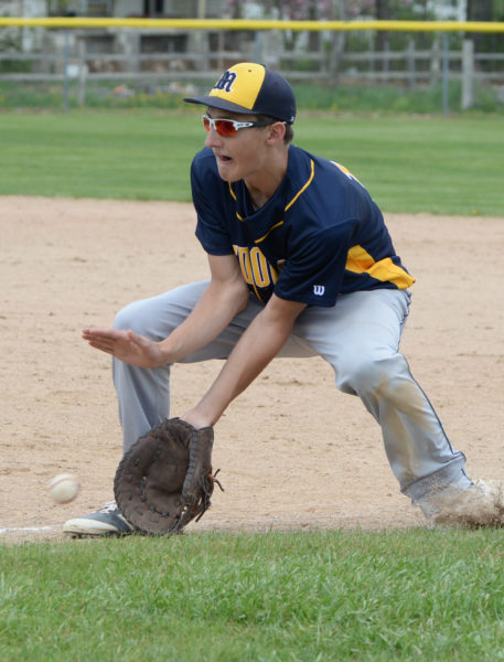 Medomak first baseman Gabe Allaire scoops up a ground ball.  (Paula Roberts photo)