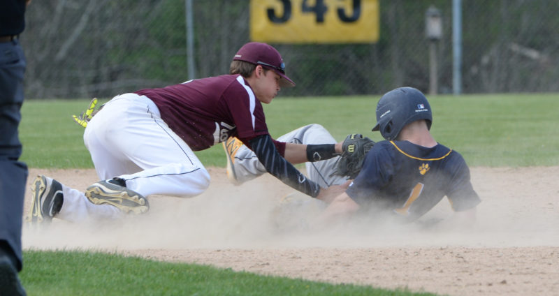 Brent Stewart is tagged out by Nokomis shortstop Josh Smestad while trying to stretch a single.  (Paula Roberts photo)