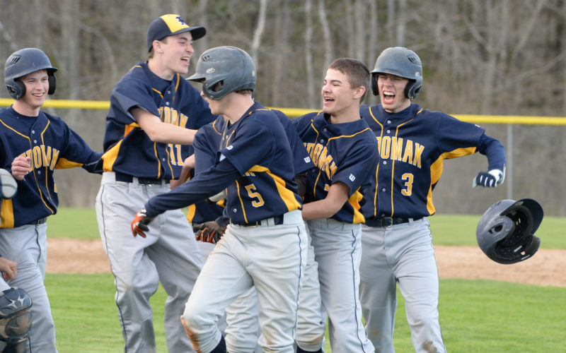 Medomak Valley's baseball team celebrate their 10 inning 5-4 win over Lincoln Academy on May 9 in Waldoboro.  (Paula Roberts photo)