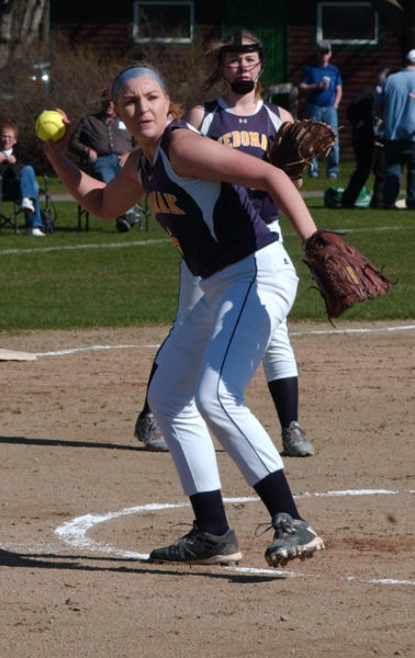 Medomak Valley pitcher Gabby DePatsy throws the ball to first to pick up the out. DePatsy pitched a perfect game on May 3 in the Lady Panthers 15-0 win over MCI. (Carrie Reynolds photo)