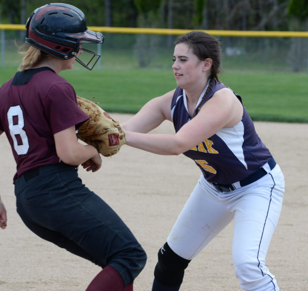 Medomak first baseman Lydia Simmons fi elded a ground ball and tags out Savannah McTogue. (Paula Roberts photo)