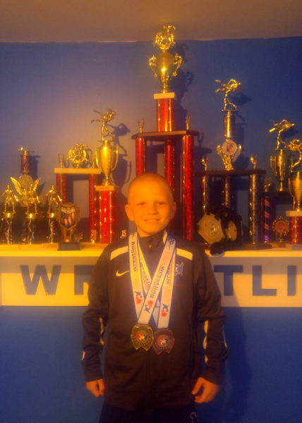 Adam St. Cyr, of Jefferson, was crowned regional freestyle wrestling champion.