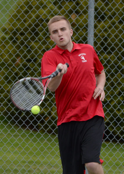 Wiscasset senior Ethan James returns a shot in boys tennis action on May 10. (Paula Roberts photo)