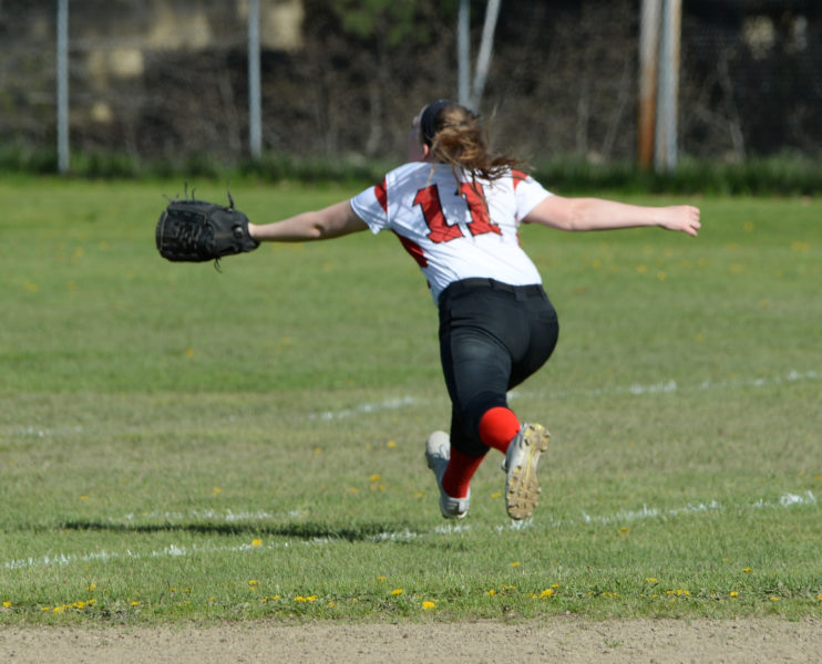 Wiscasset shortstop Maeve Blodgett runs down a fly ball in foul territory. (Paula Roberts photo)