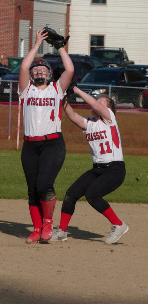 Sydnie Thayer holds onto the ball for the catch with a collision with Wiscasset teammate Maeve Blodgett. (Carrie Reynolds photo)