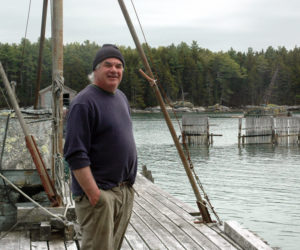 Community Shellfish LLC owner Boe Marsh stands on the dock of the Bremen Lobster Pound Co-Op on Keene Neck in Bremen. (Alexander Violo photo)
