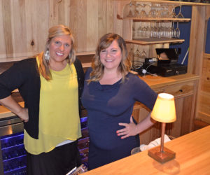 Taylor Corson and Cerina Leeman behind the bar of The Harbor Room in New Harbor on Monday, June 19. The longtime friends plan to reopen the restaurant in mid-July. (Maia Zewert photo)
