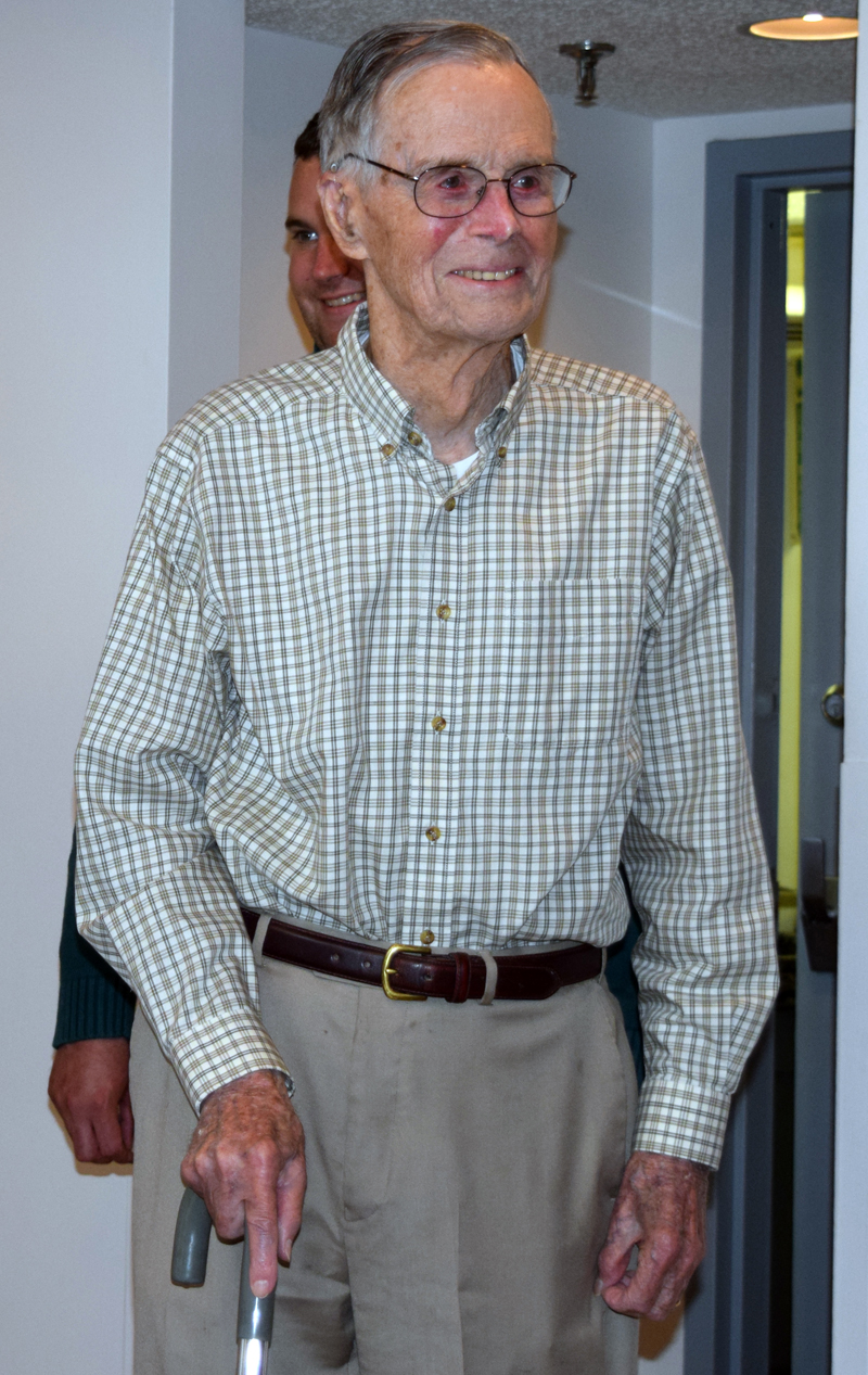 Harry Emmons arrives for his 100th birthday party in the Schooner Cove dining room Friday, June 9. (J.W. Oliver photo)