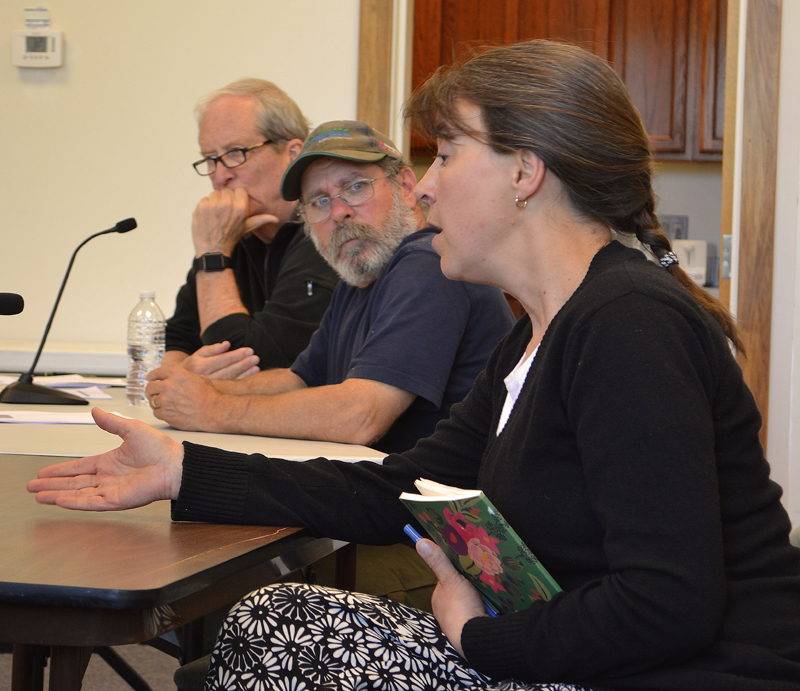 Our Town Damariscotta organizer Jenny Mayher speaks while Damariscotta Planning Board members Bruce Garren (left) and Jonathan Eaton look on during a workshop with the Damariscotta Board of Selectmen on Wednesday, June 7. (Maia Zewert photo)