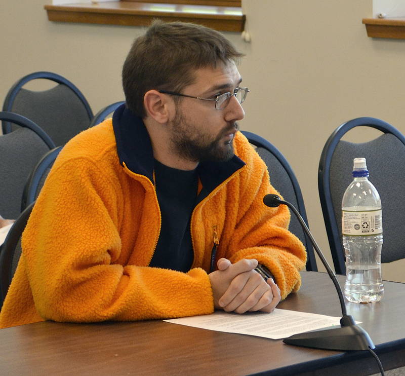 Ranger Langdon, of Newcastle, an employee of Hannaford Supermarket in Damariscotta, asks the Damariscotta Board of Selectmen for action on plastic bags during the board's meeting Wednesday, June 7. (Maia Zewert photo)