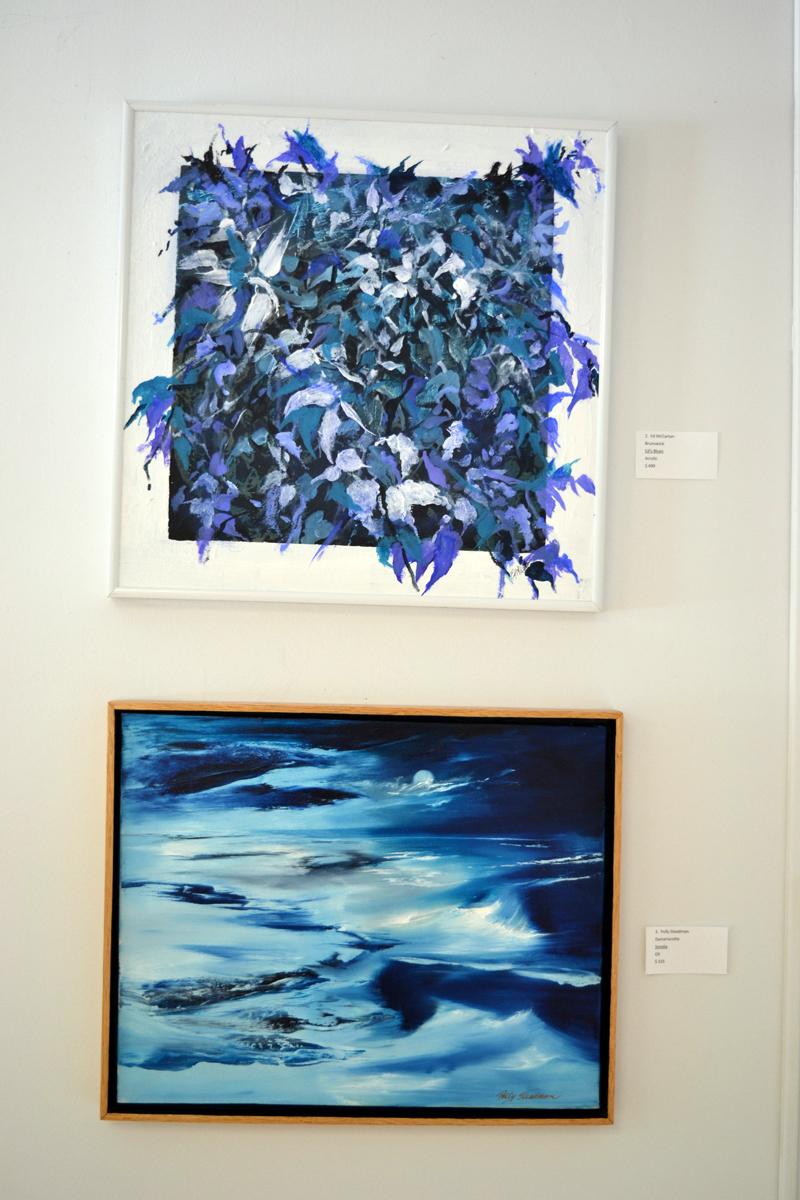 "Brunswick artist Ed McCartan's ""Ed's Blues"" hangs above ""Sonata,"" painted by Polly Steadman, of Damariscotta. (Christine LaPado-Breglia photo)"