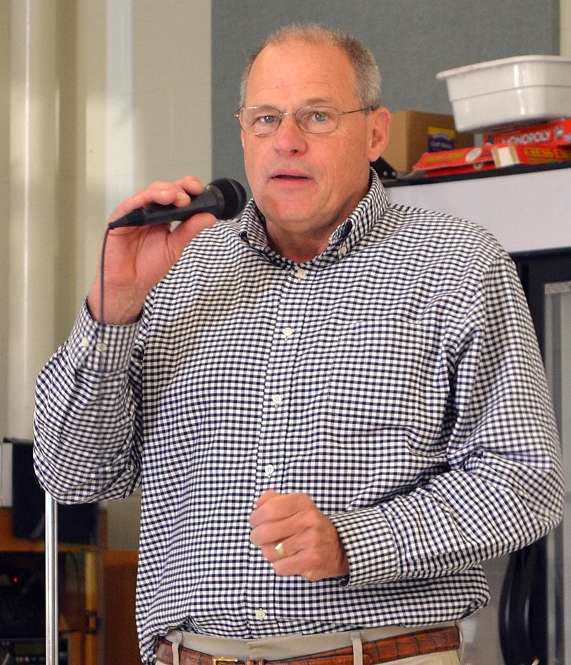 Damariscotta Town Manager Matt Lutkus welcomes attendees of the annual town meeting Wednesday, June 14. (Maia Zewert photo)