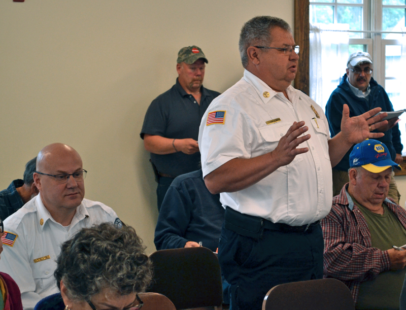 Gardiner Fire and Rescue Chief Al Nelson speaks at Dresden's annual town meeting Saturday, June 17, as Wiscasset Ambulance Service Director Toby Martin (left) looks on. (Abigail Adams photo)