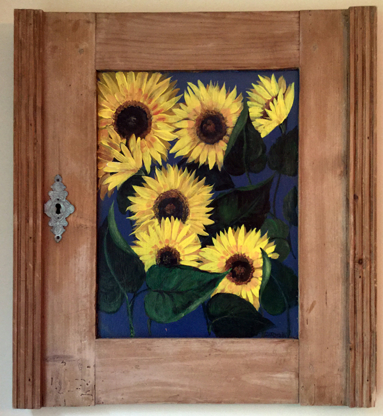 "This painting of sunflowers on a salvaged cupboard door by Florida artist Diane Tonelli is one of many paintings to be on display at the upcoming ""Art in Bloom"" show at the St. Andrew's Episcopal Church Parish House in Newcastle. (Photo courtesy Ruth Piper)"