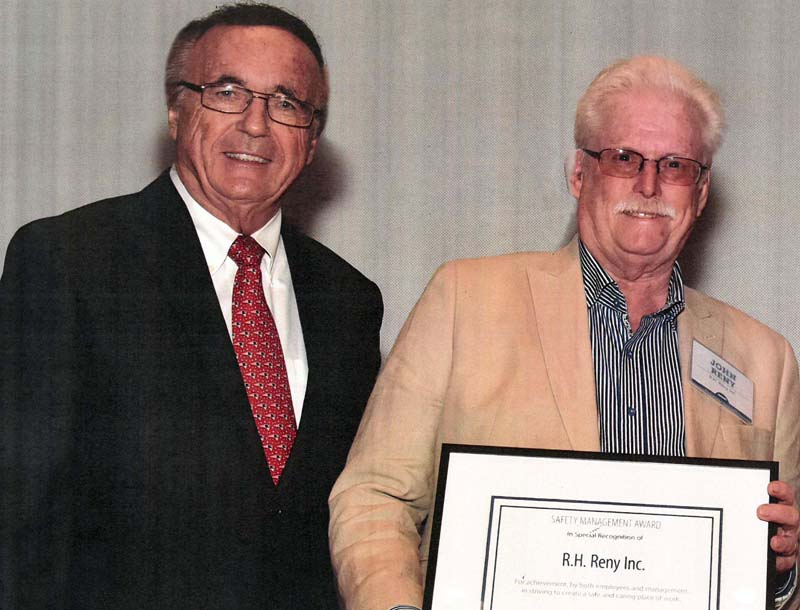 R.H. Reny Inc. President John Reny (right) receives an award for outstanding safety performance during the Maine Employers' Mutual Insurance Co.'s annual meeting of policyholders in early June.