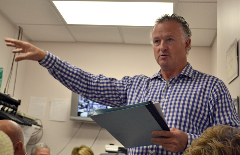 Jack Freker, one of the members of The Standard of Newcastle Condominium Association, talks about Kieve-Wavus Education Inc.'s plans to purchase the boathouse behind the condominium building during the Newcastle Board of Selectmen's meeting Monday, June 12. (Maia Zewert photo)