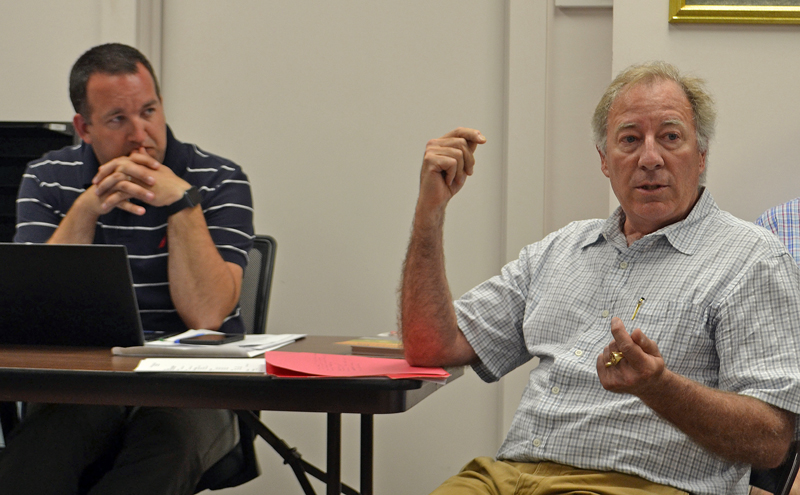 Kieve-Wavus Education Inc. Executive Director Henry Kennedy (right) discusses the organization's plans for the boathouse as Newcastle Town Administrator Jon Duke looks on. (Maia Zewert photo)