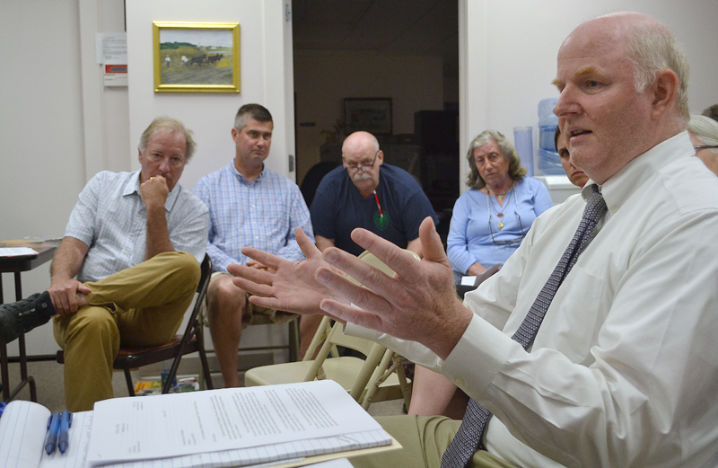 Hylie West, the attorney for The Standard of Newcastle Condominium Association, discusses the association's objection to Kieve-Wavus Education Inc.'s plans for the boathouse as Kieve-Wavus Executive Director Henry Kennedy (left) looks on. (Maia Zewert photo)