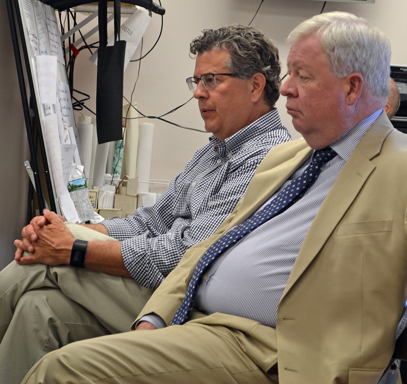 Lincoln Academy Head of School David Sturdevant (left) speaks during the Newcastle Board of Selectmen's Monday, June 26 meeting as First National Bank Chief Financial Officer F. Stephen Ward looks on. (Maia Zewert photo)