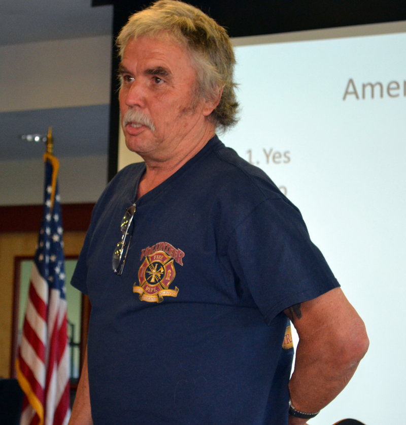 Newcastle firefighter Richard Gutek speaks against a motion to eliminate a raise for the fire chief at annual town meeting Wednesday, June 14. (Abigail Adams photo)