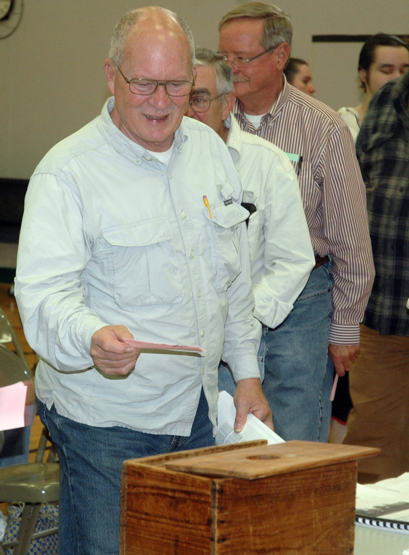 New RSU 12 Board of Directors member Russell Gates casts his ballot during Somerville's annual town meeting at the RSU 12 gymnasium Saturday, June 17. (Alexander Violo photo)