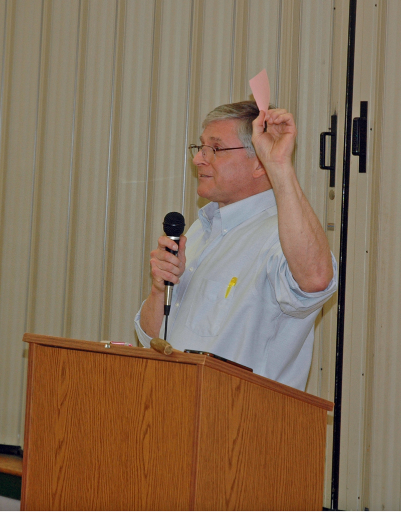 Moderator Chris Johnson discusses voting procedures at the opening of annual town meeting in Somerville. (Alexander Violo photo)