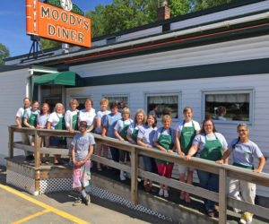 Moody's Diner employees pose in front of the restaurant to celebrate its 90th anniversary. (Photo courtesy Jasmine McNelly)