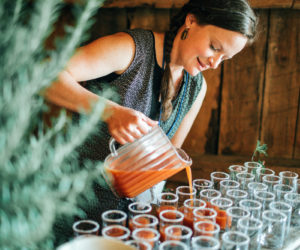 Christa Thorpe pours refreshments for Harvest Moon Catering. (Photo courtesy Jamie Mercurio Photography)