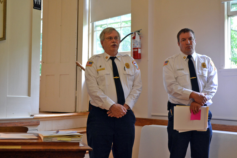 Westport Island Fire Chief Robert Mooney (left) and Deputy Fire Chief Jason Abbott present the fire department's budget to voters at annual town meeting Saturday, June 24. (Charlotte Boynton photo)