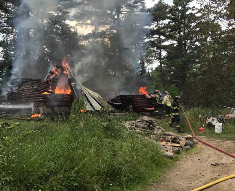 Firefighters work to extinguish a fire that destroyed a Bradford Road home in Wiscasset the afternoon of Wednesday, June 28. (photo courtesy Wiscasset Police Department)