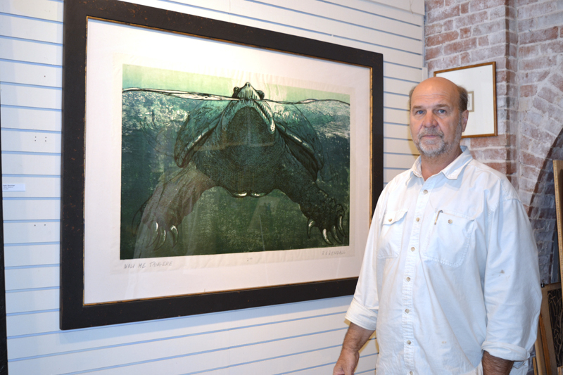 "Wiscasset artist R. Keith Rendall stands before his large woodcut of a snapping turtle, ""Noli Me Tangere,"" which took him about seven to eight months to create. (Christine LaPado-Breglia photo)"