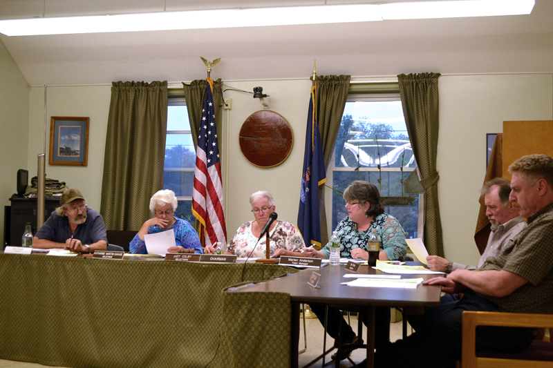 The Wiscasset Board of Selectmen votes to place the harbor master and shellfish warden under the authority of the police department Tuesday, June 27. From left: Selectmen Robert Blagden, Katharine Martin-Savage, and Judy Colby; Town Manager Marian Anderson; and Selectmen Benjamin Rines Jr. and Jefferson Slack. (Charlotte Boynton photo)