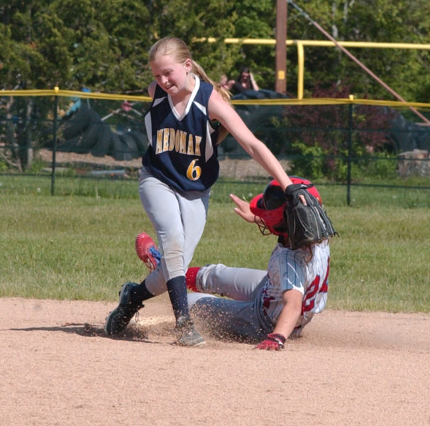 Grace Houghton slides into second safe, as Medomak's Cameron Baines attempts the tag. (Carrie Reynolds photo)