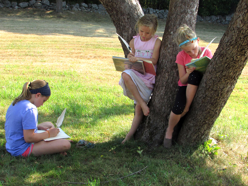 From left: Harriet McKane, Addie Miller, and Piper McKane enjoy the shade at the Old Jail in Wiscasset while writing in their journals during last year's Summer with the Past program.