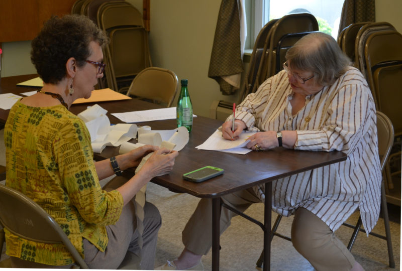 From left: Wiscasset Election Clerk Joan Barnes and Election Warden Susan Blagden retally the results of Wiscasset's annual town meeting by referendum at the Wiscasset town office on Thursday, June 22. (Abigail Adams photo)
